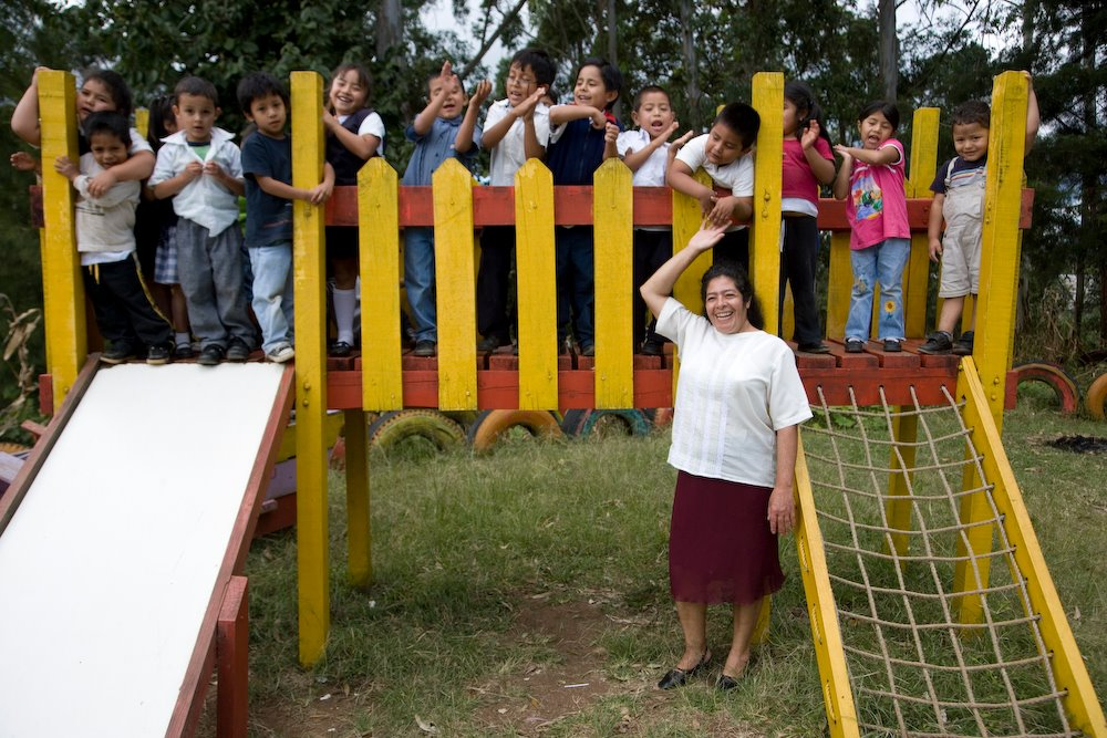 Picture of Children on the play structure with their teacher